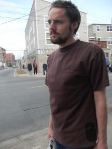 Brown shirt w/ black logo