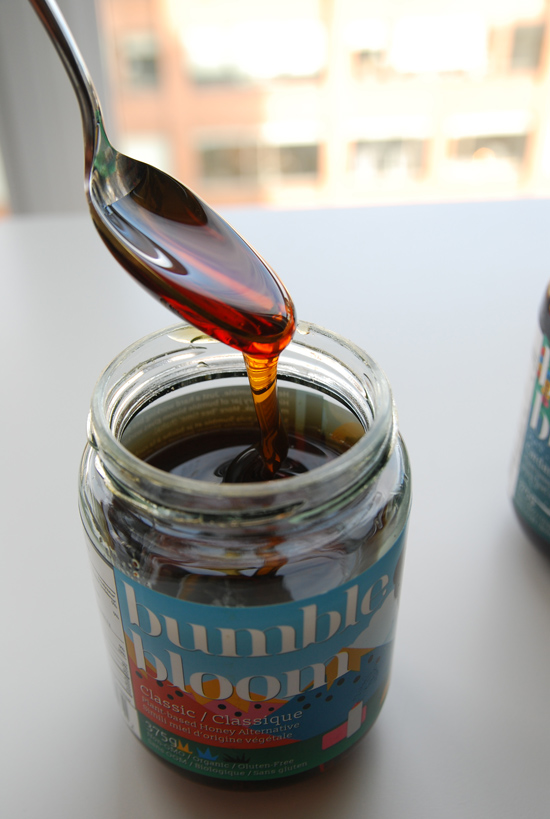 Bumble Bloom Vegan Honey Alternative dripping from spoon into jar