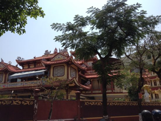 Photo of a large temple behind some trees in Quy Nhon, Vietnam
