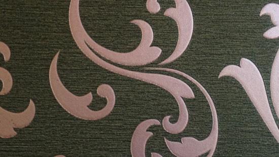 Photo contains light pink swirls on a dark grey background.